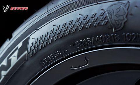Automotive tire, Text, Synthetic rubber, Font, Logo, Black, Grey, Tread, Close-up, Automotive wheel system,