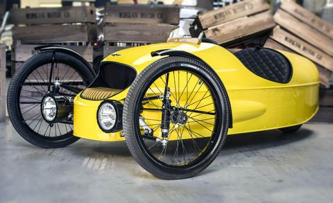 Tire, Wheel, Motor vehicle, Automotive tire, Automotive design, Mode of transport, Automotive wheel system, Yellow, Rim, Spoke,