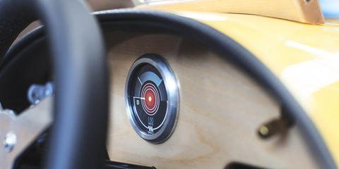 Motor vehicle, Yellow, Automotive design, Steering wheel, Steering part, Luxury vehicle, Personal luxury car, Speedometer, Supercar,