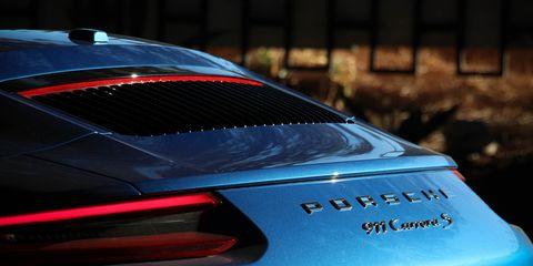 Automotive design, Vehicle, Car, Supercar, Automotive exterior, Automotive lighting, Spoiler, Sports car, Porsche, Performance car,