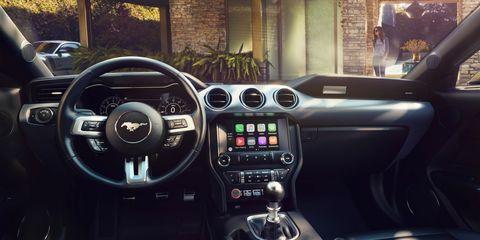 Land vehicle, Vehicle, Car, Center console, Motor vehicle, Steering wheel, Luxury vehicle, Automotive design, Family car, Audi tt,