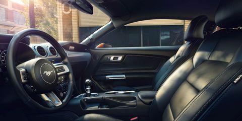 Motor vehicle, Steering part, Automotive design, Steering wheel, Vehicle door, Car, Automotive mirror, Center console, Car seat, Personal luxury car,