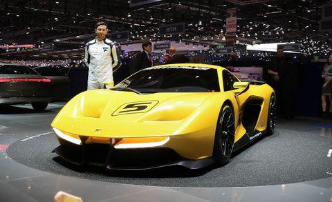 Land vehicle, Vehicle, Car, Sports car, Supercar, Auto show, Coupé, Yellow, Automotive design, Performance car,