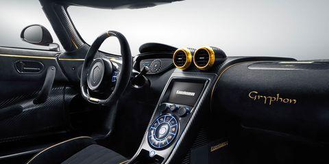 Motor vehicle, Mode of transport, Automotive design, Steering part, Steering wheel, Center console, Vehicle audio, Speedometer, Personal luxury car, Luxury vehicle,