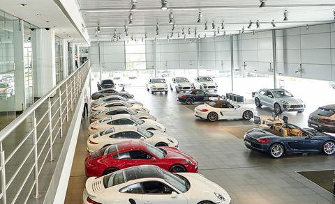 Vehicle, Motor vehicle, Car, Automotive design, Car dealership, Building, Parking, Automobile repair shop, Supercar, Executive car,