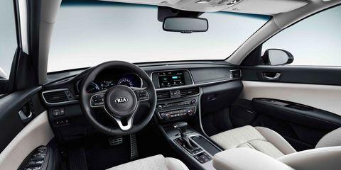Motor vehicle, Steering part, Automotive design, Steering wheel, Vehicle, Center console, Vehicle audio, White, Automotive mirror, Car,