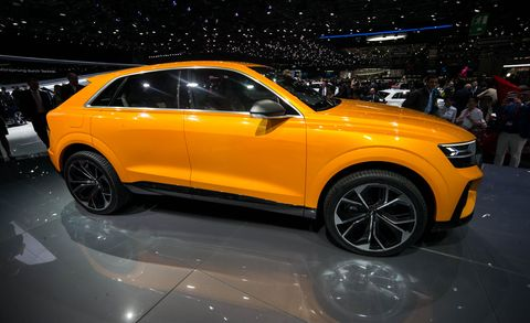 Land vehicle, Vehicle, Car, Auto show, Automotive design, Motor vehicle, Yellow, Audi, Compact sport utility vehicle, Sport utility vehicle,