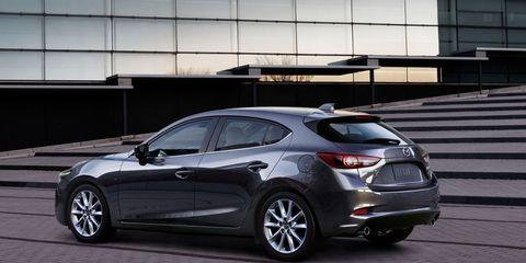 Land vehicle, Vehicle, Car, Automotive design, Mid-size car, Mazda, Hot hatch, Family car, Hatchback, Rim,