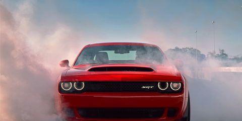 Automotive design, Vehicle, Hood, Automotive exterior, Automotive lighting, Performance car, Red, Car, Headlamp, Landscape,