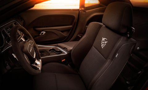 Land vehicle, Vehicle, Car, Car seat cover, Steering wheel, Center console, Gear shift, Automotive design, Car seat, Plant,