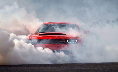 Automotive design, Car, Hood, Automotive exterior, Motorsport, Atmospheric phenomenon, Performance car, Racing, Smoke, Auto racing,
