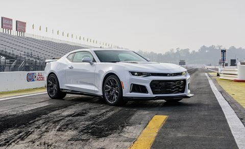 Land vehicle, Vehicle, Car, Chevrolet camaro, Automotive design, Motor vehicle, Automotive tire, Bumper, Rim, Wheel,