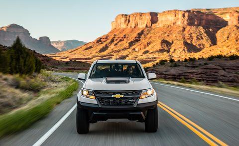 Tire, Wheel, Road, Automotive mirror, Automotive design, Vehicle, Automotive lighting, Mountainous landforms, Land vehicle, Automotive parking light,