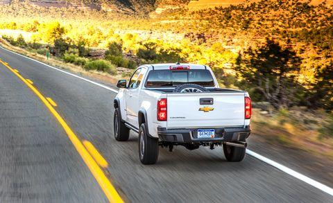Motor vehicle, Tire, Wheel, Automotive tail & brake light, Road, Pickup truck, Automotive tire, Automotive exterior, Vehicle, Automotive lighting,