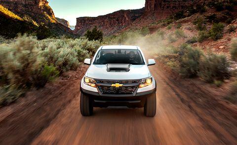 Land vehicle, Vehicle, Car, Motor vehicle, Off-roading, Chevrolet, Automotive design, Landscape, Pickup truck, Terrain,