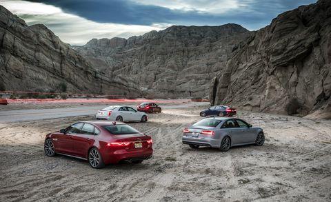 Tire, Wheel, Mountainous landforms, Vehicle, Land vehicle, Automotive design, Automotive tail & brake light, Car, Mountain range, Full-size car,