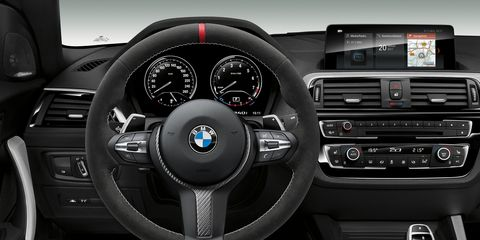 Motor vehicle, Steering part, Automotive design, Steering wheel, Product, Center console, Speedometer, Car, White, Vehicle audio,