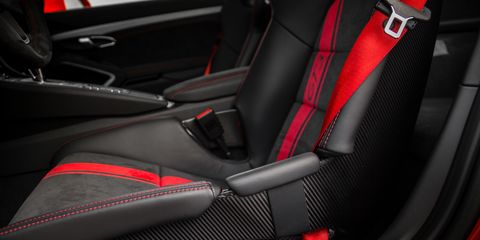 Motor vehicle, Mode of transport, Automotive design, Red, Car seat, Carmine, Carbon, Luxury vehicle, Car seat cover, Vehicle door,