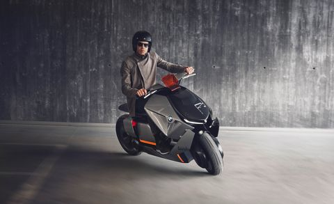 Vehicle, Motorcycle, Mode of transport, Automotive design, Scooter, Automotive wheel system, Wheel, Automotive tire, Car, Stunt performer,
