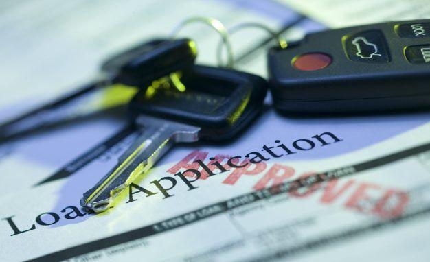 car keys on top of loan application