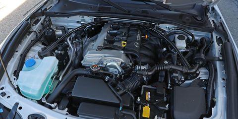Land vehicle, Vehicle, Car, Engine, Auto part, Personal luxury car, Mid-size car, Automotive engine part, Sedan,