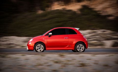 Tire, Wheel, Automotive design, Automotive mirror, Mode of transport, Vehicle, Land vehicle, Car, Red, Automotive lighting,
