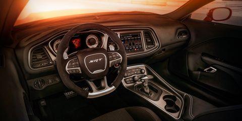 Land vehicle, Vehicle, Car, Center console, Motor vehicle, Steering wheel, Executive car, Automotive design, Gear shift,