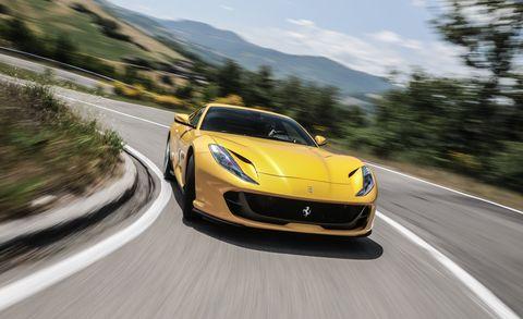 Land vehicle, Vehicle, Car, Supercar, Sports car, Performance car, Automotive design, Yellow, Luxury vehicle, Coupé,