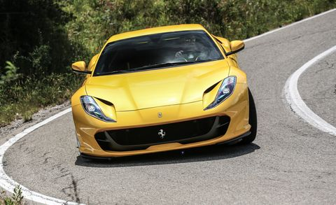 Land vehicle, Vehicle, Car, Supercar, Yellow, Performance car, Automotive design, Sports car, Hood, Bumper,