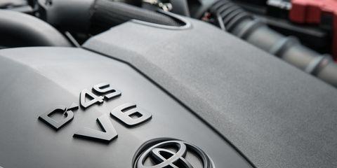 Motor vehicle, Vehicle, Car, Auto part, Automotive wheel system, Emblem, Wheel, Automotive exterior, Toyota, Mid-size car,