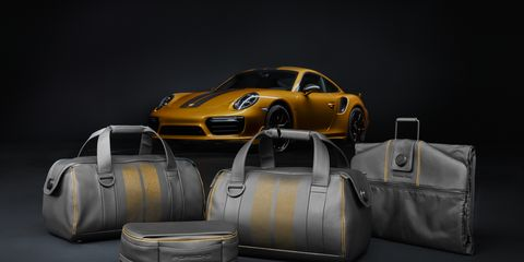 Automotive design, Bag, Luggage and bags, Shoulder bag, Sports car, Bumper, Performance car, Brand, Luxury vehicle, Hardtop,
