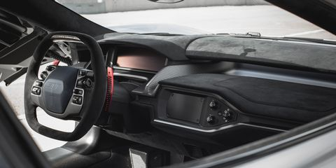Motor vehicle, Mode of transport, Automotive design, Steering part, Steering wheel, Glass, Speedometer, Center console, Windshield, Personal luxury car,