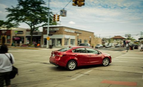 Tire, Automotive tail & brake light, Vehicle, Alloy wheel, Road, Car, Rim, Street, Full-size car, Mid-size car,