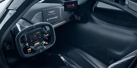 Land vehicle, Vehicle, Car, Automotive design, Center console, Luxury vehicle, Steering wheel, Auto part, Gauge, City car,