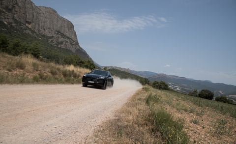 Vehicle, Car, Road, Dirt road, Mountain pass, Plant community, Luxury vehicle, Ecoregion, Infrastructure, Off-roading,