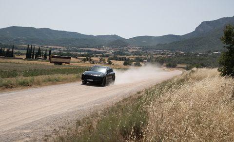 Automotive design, Road, Mountainous landforms, Automotive exterior, Hill, Highland, Car, Mountain range, Plain, Automotive lighting,