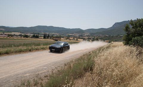 Road, Automotive design, Mountainous landforms, Car, Mountain range, Automotive exterior, Highland, Hill, Plain, Rim,
