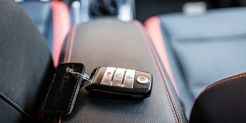 Vehicle, Car, Leather, Auto part, Car seat, Center console, Gear shift, Family car, Seat belt,