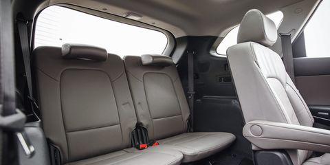Motor vehicle, Mode of transport, Car seat, Head restraint, Car seat cover, Seat belt, Vehicle door, Luxury vehicle, Family car, Automotive window part,