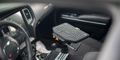 Motor vehicle, Vehicle, Car, Center console, Steering wheel, Technology, Mid-size car, Car seat, Executive car, Gear shift,
