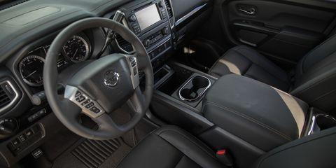 Motor vehicle, Steering part, Automotive design, Steering wheel, White, Center console, Vehicle door, Car seat, Luxury vehicle, Vehicle audio,