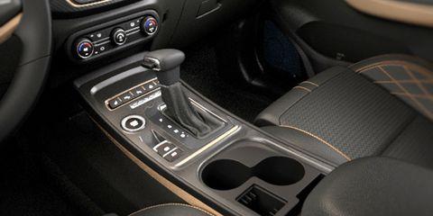 Land vehicle, Vehicle, Car, Center console, Gear shift, Executive car, Compact car, Family car, Metal,