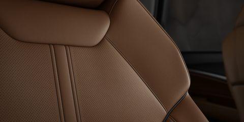 Tan, Car, Vehicle, Car seat, Leather, Car seat cover, Beige, Automotive design, Luxury vehicle, Auto part,