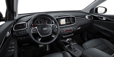 Land vehicle, Vehicle, Car, Center console, Motor vehicle, Kia sorento, Steering wheel, Automotive design, Kia motors, Family car,
