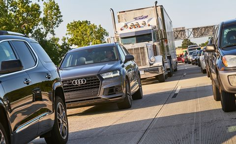 Land vehicle, Vehicle, Car, Automotive design, Transport, Luxury vehicle, Sport utility vehicle, Audi, Road, Bumper,