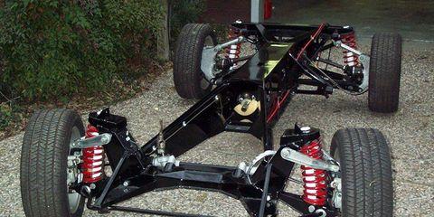 Land vehicle, Vehicle, Formula libre, Car, Automotive tire, Tire, Motor vehicle, Wheel, Rim, Suspension,