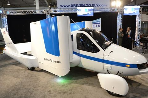 """The wings fold up in a demonstration of the Terrafugia """"Flying Car"""" during the first day of press previews at the New York International Automobile Show April 4, 2012."""