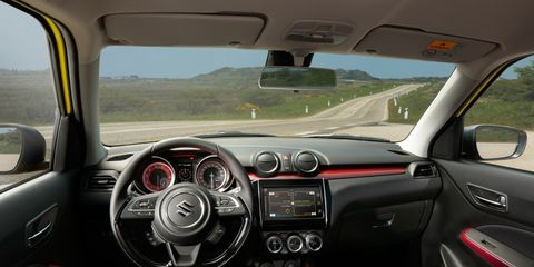 Land vehicle, Vehicle, Car, Vehicle audio, Center console, Subcompact car, Steering wheel, Audi a1, Compact car, Mazda,