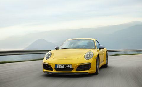 Land vehicle, Vehicle, Car, Automotive design, Supercar, Yellow, Performance car, Sports car, Luxury vehicle, Porsche,