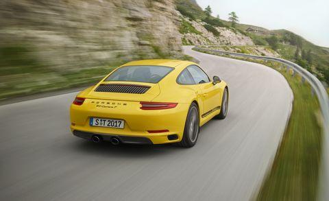Land vehicle, Vehicle, Car, Supercar, Yellow, Sports car, Automotive design, Performance car, Porsche, Road,